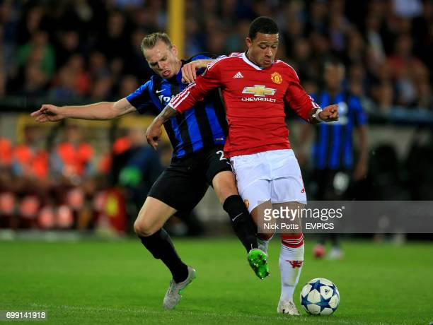 Club Brugge's Laurens De Bock and Manchester United's Memphis Depay in action