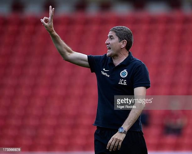 Club Brugge's manager Juan Carlos Garrido gestures as his team plays Barnsley during a preseason friendly at Oakwell Stadium on July 12 2013 in...