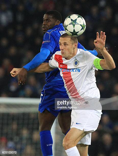 Club Brugge's midfielder Timmy Simons tackles Leicester City's striker Jeff Schlupp during their Champions League Group G soccer match between...