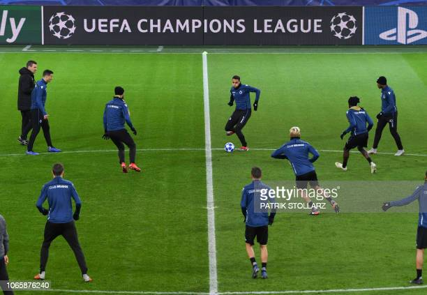 Club Brugge's Moroccan midfielder Sofyan Amrabat controls the ball during a training session on the eve of the UEFA Champions League group A football...