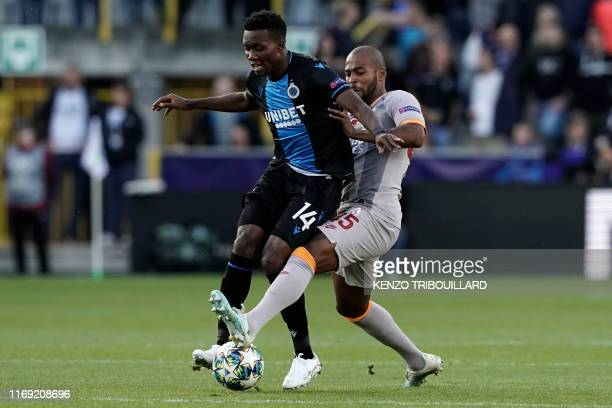 Club Brugge's Nigerian forward David Chidozie Okereke vies with Galatasaray's Brazilian defender Marcao Teixeira during the UEFA Champions League...