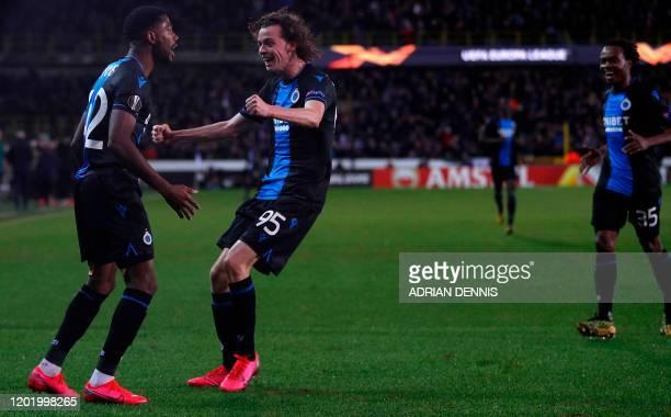 Club Brugge's Nigerian forward Dennis Emmanuel Bonaventure celebrates with his teammate Maxim De Cuyper after scoring his team's first goal during...