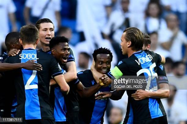 Club Brugge's Nigerian forward Emmanuel Bonaventure celebrates with teammates after scoring during the UEFA Champions league Group A football match...