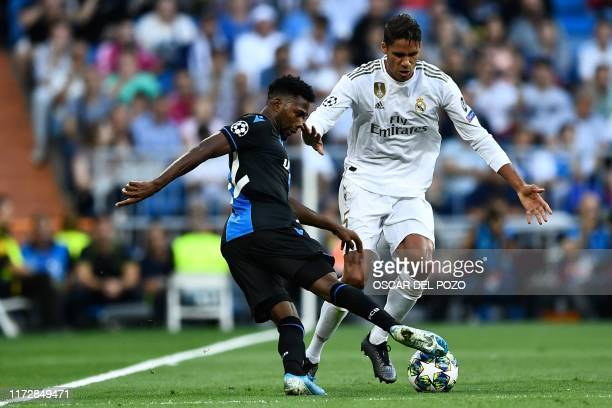 Club Brugge's Nigerian forward Emmanuel Bonaventure challenges Real Madrid's French defender Raphael Varane during the UEFA Champions league Group A...