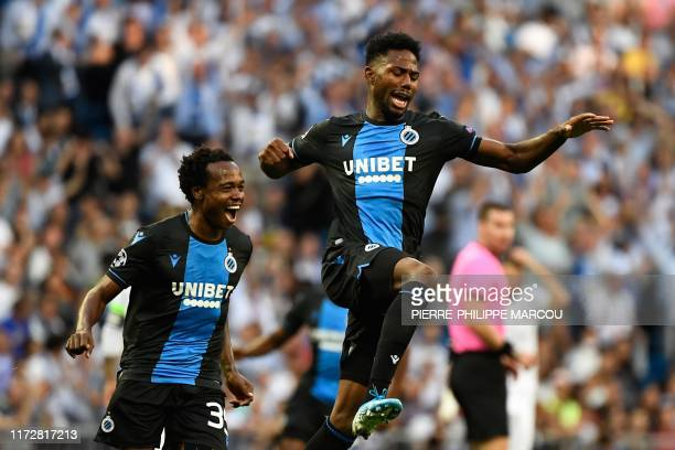 Club Brugge's Nigerian forward Emmanuel Bonaventure reacts after scoring a goal during the UEFA Champions league Group A football match between Real...