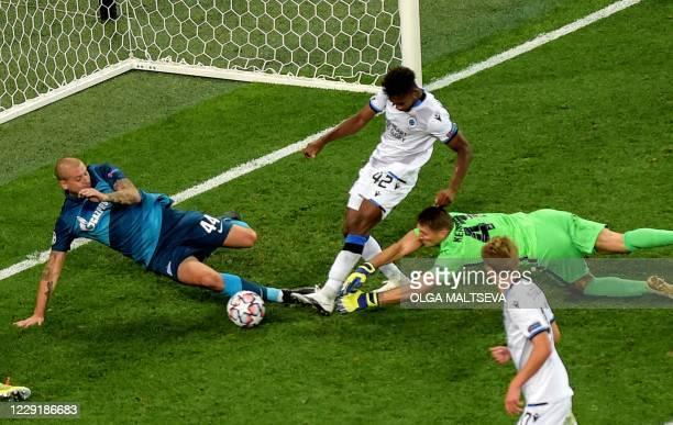 Club Brugge's Nigerian forward Emmanuel Dennis Bonaventure scores a goal past Zenit St. Petersburg's Ukrainian defender Yaroslav Rakitskiy and Zenit...