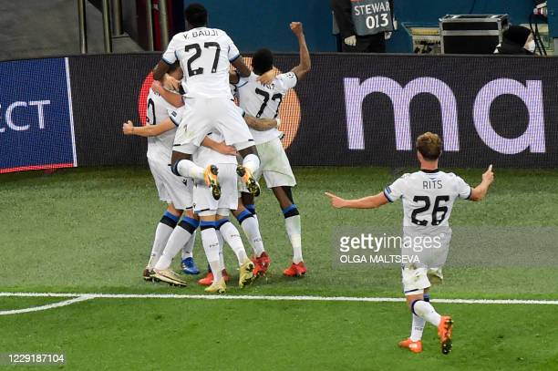 Club Brugge's players celebrate after scoring a goal during the UEFA Champions League Group F football match between Zenit St Petersburg and Club...