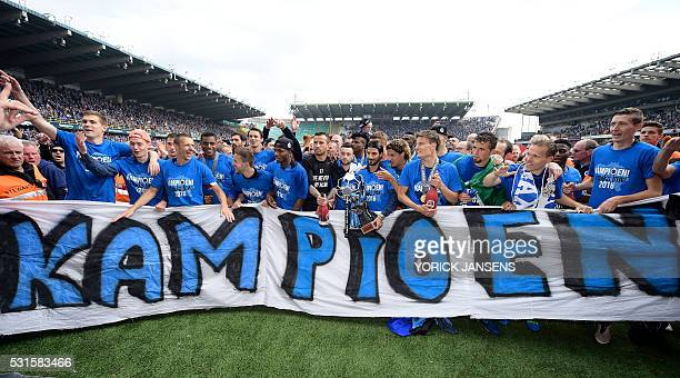 TOPSHOT Club Brugge's players celebrate after winning for the first time in 11 years the Belgian soccer championship Jupiler Pro League match between...