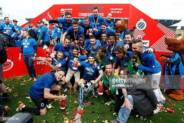 Club Brugge's players celebrate after winning the Jupiler Pro League match between Club Brugge and RSC Anderlecht in Brugge on May 15 2016 / AFP /...