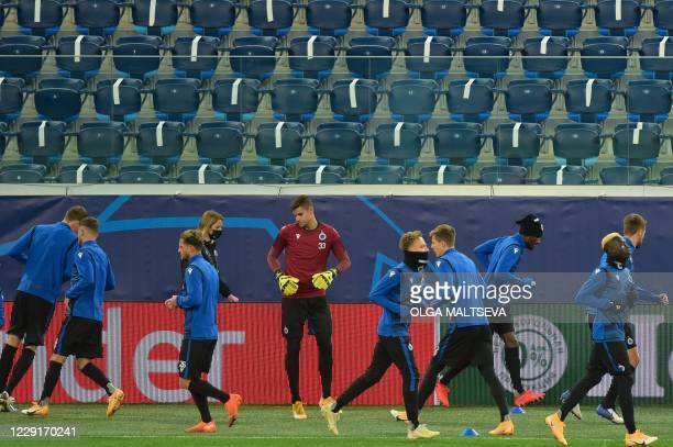 Club Brugge's players take part in a training session at the Saint Petersburg Stadium in Saint Petersburg on October 19 2020 on the eve of the UEFA...
