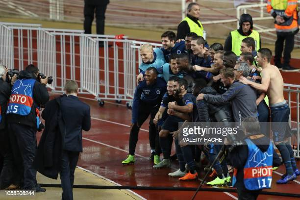Club Brugge's pose as they celebrate their 4-0 victory at the end of the UEFA Champions League Group A football match between AS Monaco and Club...