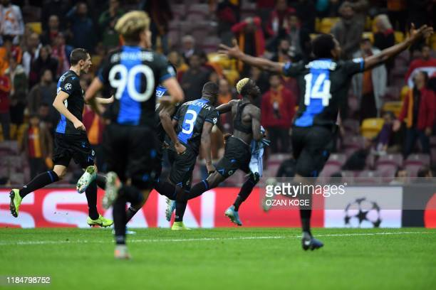 Club Brugge's Senegalese midfielder Krepin Diatta celebrates after scoring a goal during the UEFA Champions League football match between Galatasaray...