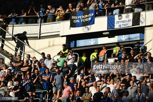 Club Brugge's supporters wait for the start of the UEFA Champions league Group A football match between Real Madrid and Club Brugge at the Santiago...