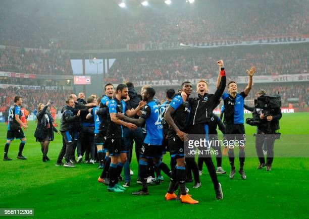 Club Brugge's team celebrate their new champion title after the Jupiler Pro League match Standard de Liege vs Club Brugge in Liege on May 13 on day...
