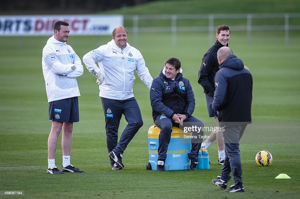 Club Doctor Paul Catterson (L) Goal Keeping Coach Andy Woodman (2nd from left) Assistant Manager John Carver (2nd from right) and First Team Fitness Coach Dave Billows (R) smile at Steve Stone (back to camera) during a training session at The Newcastle United Training Centre on October 30, 2014, in Newcastle upon Tyne, England.