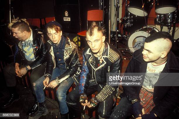 100 Club London a group of punks wearing heavily studded and customised clothing looking bored UK 1984