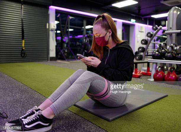 Club member Francesca Williams, aged 20, returns to the gym at the St Michael's Health Club shortly after 6am on April 12, 2021 in Falmouth, England....