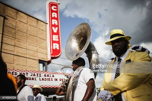 Club members march past the historic Carver Theater named for former slave and famed botanist and inventor George Washington Carver during the Zulu...