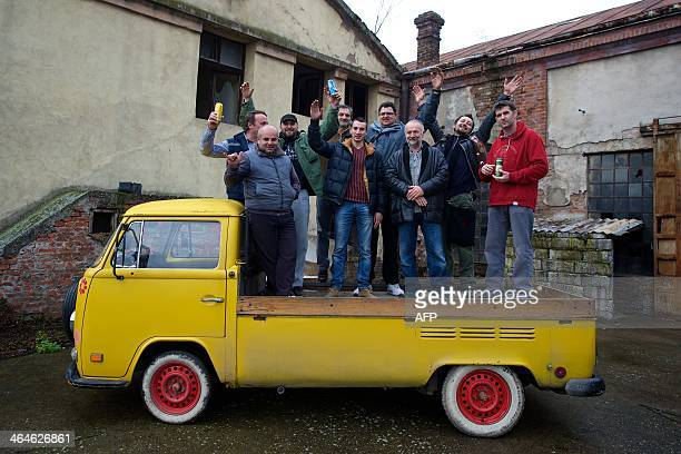 VW club members pose on the back of a Volkswagen T2 in a private workshop on January 21 in Sabac 100 km west of Belgrade The last Kombi factory in...