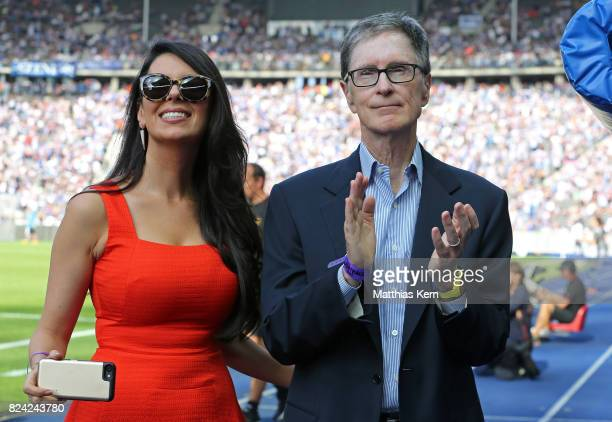Club owner John Henry of Liverpool and his wife Linda Pizutti look on prior to the pre season friendly match between Hertha BSC and FC Liverpool at...