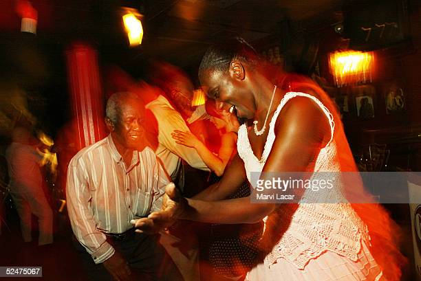 Club regulars swing dance at the Cotton Club in the Harlem neighborhood June 14 2004 in New York City The Cotton Club was one of Harlem's hot spots...
