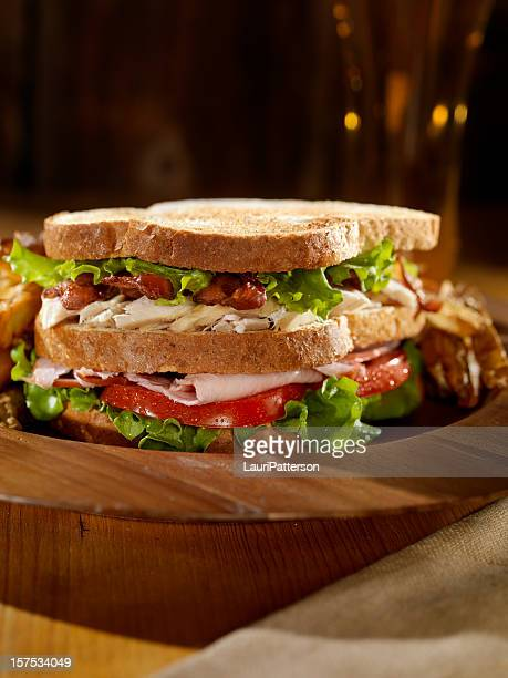 club sandwich with french fries and a beer - club sandwich stock pictures, royalty-free photos & images