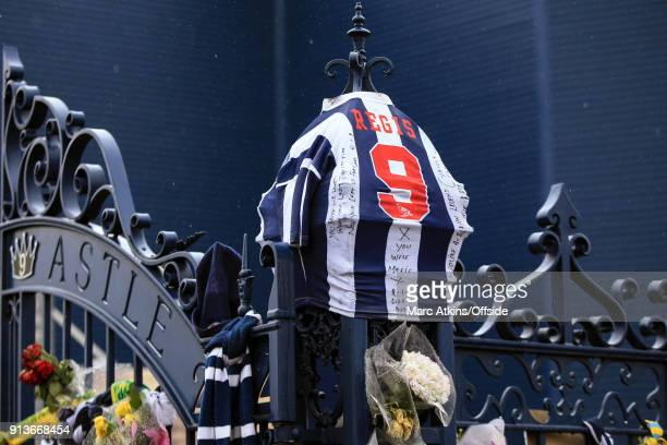 A club shirt bearing the name of Cyrille Regis stretched over the Jeff Astle gates prior to the Premier League match between West Bromwich Albion and...