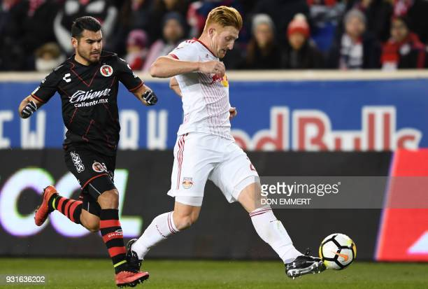 Club Tijuana's Alberto Garcia and New York Red Bulls Daniel Royer vie for the ball during the Concacaf Champions League 2nd Leg Quarterfinal football...
