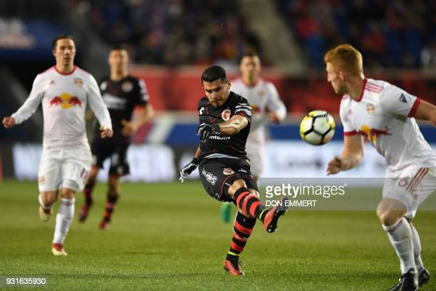 Club Tijuana's Alberto Garcia shoots during the Concacaf Champions League 2nd Leg Quarterfinal football match between the New York Red Bulls and Club...