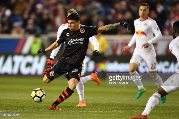 Club Tijuana's Luis Angel Mendoza shoots the ball during the Concacaf Champions League 2nd Leg Quarterfinal football match between the New York Red...