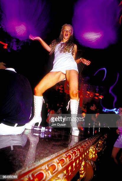 A clubber dances on a table during the opening night of the season for Manumission at Privilege nightclub in June 2001 in Ibiza