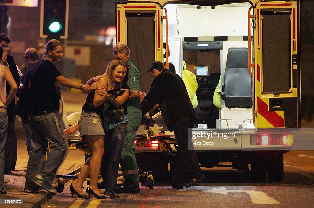 A clubber is helped into an ambulance to accompany her friend to hospital after she collapsed in a club in Bristol City Centre on October 15, 2005 in Bristol, England. Pubs and clubs preparing for the new Licensing laws due to come into force on November 24 2005, which will allow pubs and clubs longer and more flexible opening hours.Opponents of the law believe this will lead to more binge-drinking with increased alcohol related crime, violence and disorder while health experts fear an increase in alcohol related illnesses and alcoholism.