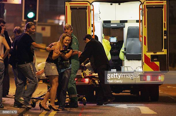 A clubber is helped into an ambulance to accompany her friend to hospital after she collapsed in a club in Bristol City Centre on October 15 2005 in...