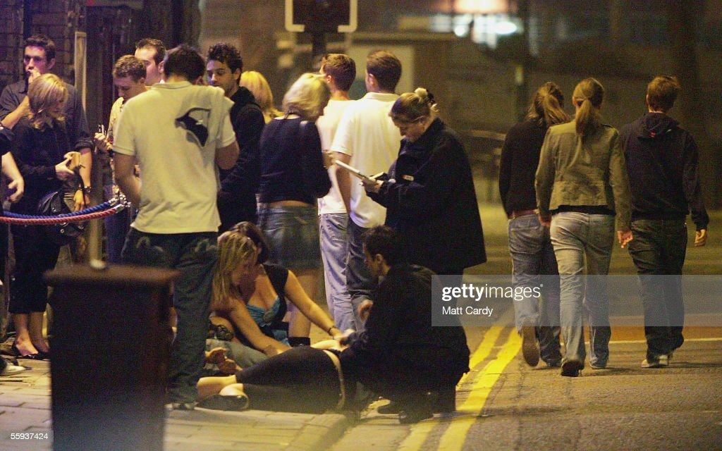 A clubber lies on the pavement after she collapsed in a club in Bristol City Centre on October 15, 2005 in Bristol, England, as pubs and clubs prepare for the new Licensing laws due to come into force on November 24 2005, which will allow pubs and clubs longer and more flexible opening hours. Opponents of the law believe this will lead to more binge-drinking with increased alcohol related crime, violence and disorder while health experts fear an increase in alcohol related illnesses and alcoholism.