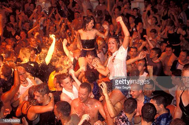 Clubbers at a water party night in crowded nightclub in San Antonio, Ibiza, Spain