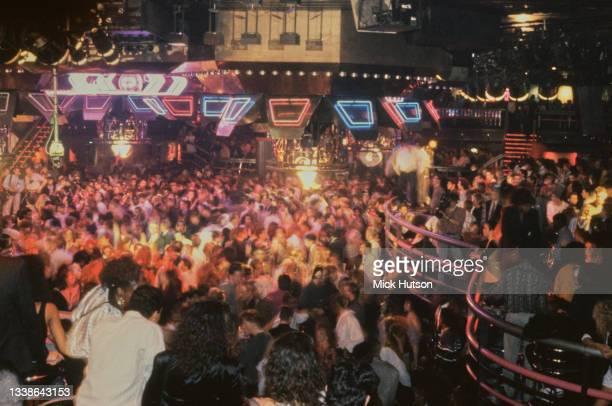 Clubbers at the Hammersmith Palais nightclub, London, UK, circa 1990.