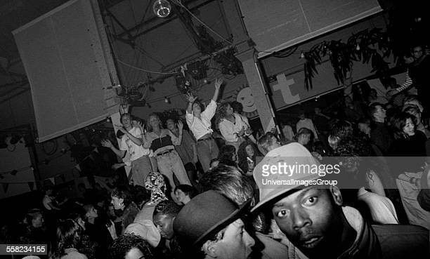 Clubbers dance on the podiums at the HOT night in the Hacienda Manchester 1988