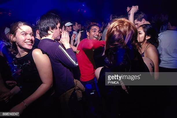 Clubbers dancing at World DJ Day Fabric London March 2002.