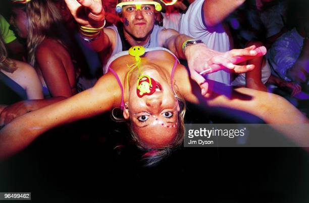 Clubbers enjoy the atmosphere at the Homelands dance music festival held at the Matterley Bowl on May 26 2001 in Winchester England