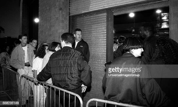 Clubbers wait as the queue for the Hacienda grows longer On the right people are let in on the guest list Manchester UK