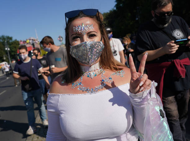 """DEU: Clubbing Enthusiasts Dance In The """"Love World Peace Parade"""" During The Coronavirus Pandemic"""