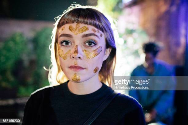 Clubgoer With Gold Glitter On Her Face