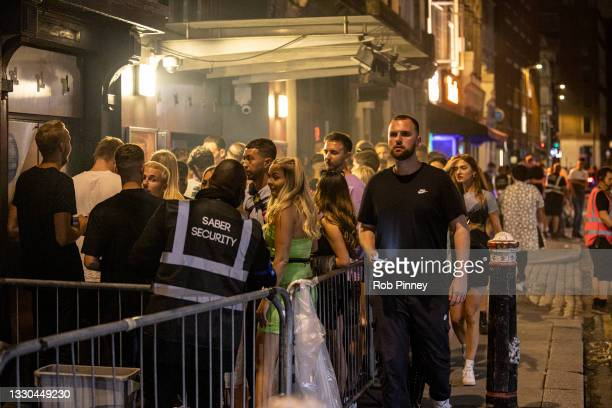 Club-goers queue outside Fabric nightclub on July 24, 2021 in London, England. On Monday, July 19th the remaining Coronavirus lockdown measures...