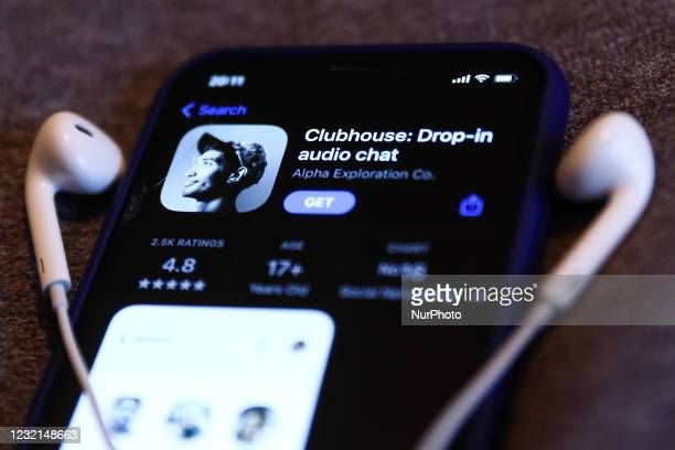 Clubhouse Drop-in audio chat app logo on the App Store is seen displayed on a phone screen in this illustration photo taken in Krakow, Poland on...