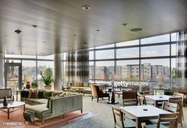 clubhouse in highrise apartment building - entrance hall stock pictures, royalty-free photos & images