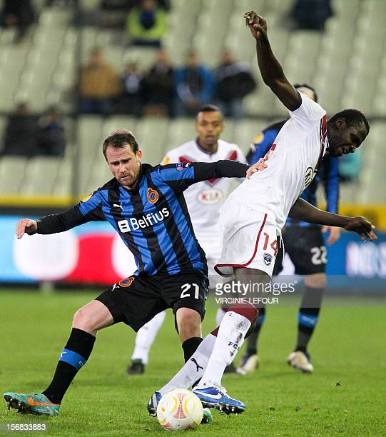 Club's Bart Buysse vies for the ball with Bordeaux's Ludovic Obraniak during the UEFA Europa league Group D match between Club Brugge KV and FC...