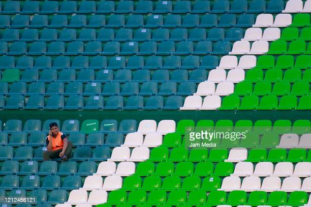 A club's employee watches from the empty seats during the 10th round match between Leon and Pumas UNAM as part of the Torneo Clausura 2020 Liga MX at...
