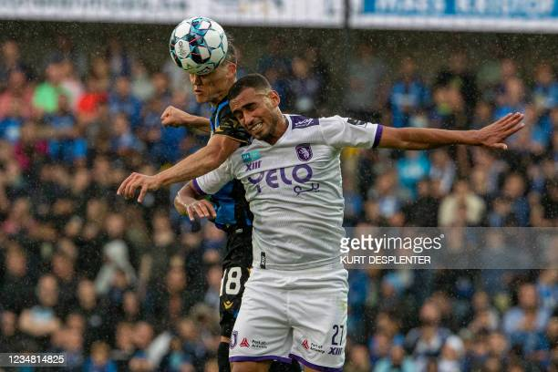 Club's Federico Ricca and Beerschot's Mohamed Reda Halaimia fight for the ball during a soccer match between Club Brugge KV and Beerschot VA, Sunday...