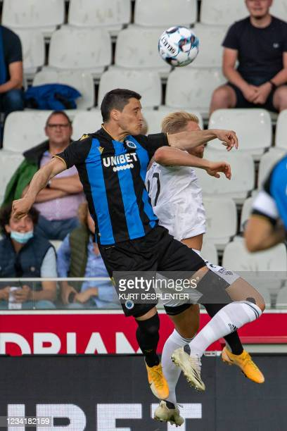 Club's Federico Ricca and Eupen's Andreas Beck fight for the ball during a soccer match between Club Brugge and KAS Eupen, Sunday 25 July 2021 in...