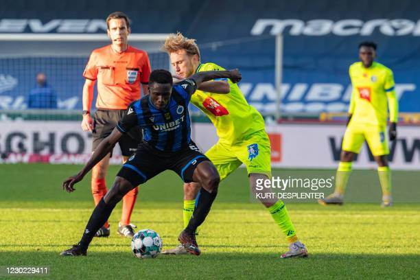 Club's Odilon Kossounou and Gent's Roman Bezus fight for the ball during a soccer match between Club Brugge KV and KAA Gent, Sunday 20 December 2020...